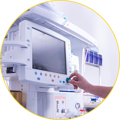 Hand adjusting a hospital device monitor