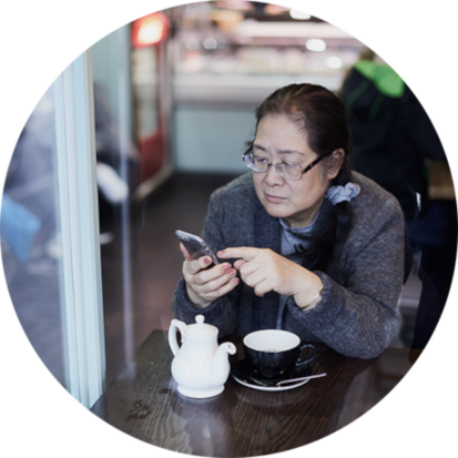 Woman in cafe using digital health and connected health app on smart phone