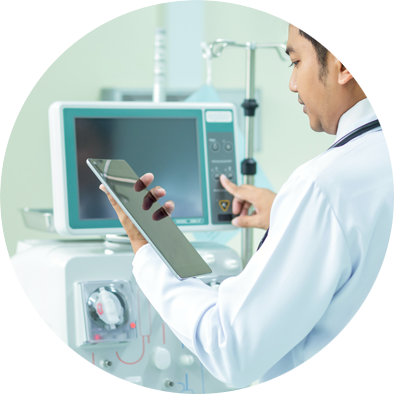 clinician with tablet working on an in-hospital connected device